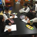 Fourth graders designing a Halloween costume.
