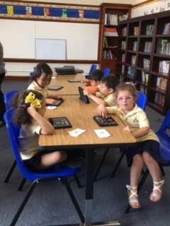 PREK 4A using IPADS in our new Media Center.