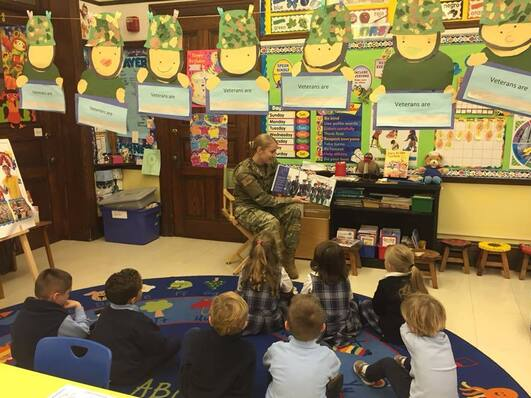 Sgt. Julie (Murray) Sutherland '03 visits Assumption School reading to the Kindergarteners as part of their Veterans Day studies.
