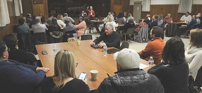 December 2019; At Large Hall, parishioners consult with representatives of the Archdiocese.