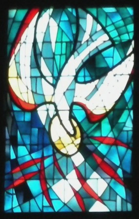 The Highest Window In Church Is Above Altar On West Wall This Depicts Holy Spirit As A Descending Dove And Situated Directly