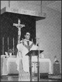 Fr. Kamel saying Mass in the first chruch on the property.