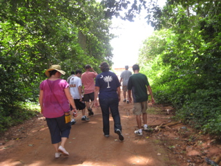 Hiking along Monkey Sanctuary trail in Ghana.