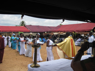 Giving gifts offerings during Mass in Awaso Village.
