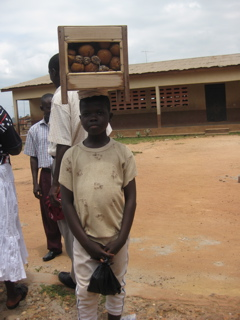 Simon outside of Awaso Village school selling us hot buns.