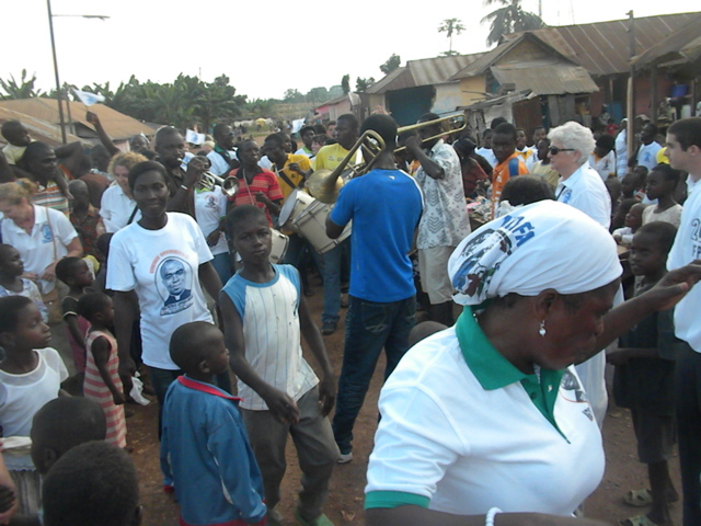 Dancing and parading with Awaso Village band.