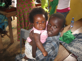 Child and babe in church.