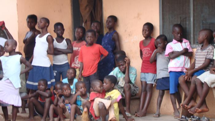 Children in the Awaso Village courtyard watching us being blessed by Head Chief.