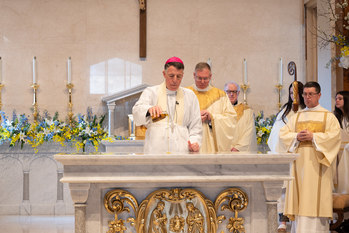 Parishioners worship at Mass in newly-renovated church