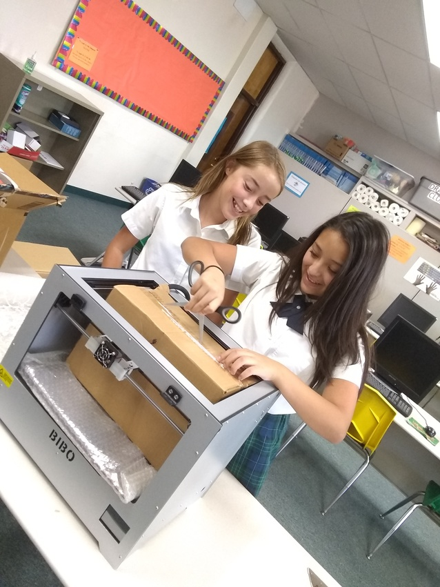 students unbox our new 3d printer