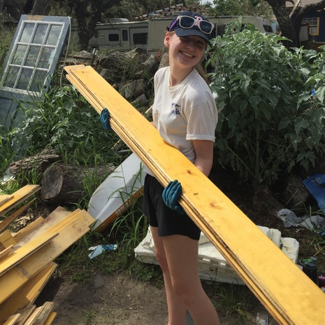 Abby does some heavy lifting on our Texas Mission Trip!
