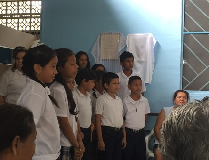 Guayaquil children singing at Damien House Chapel