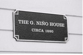 The 1880 home of Graziano Nino has been preserved and now stands with a plaque marking its history in Los Gatos