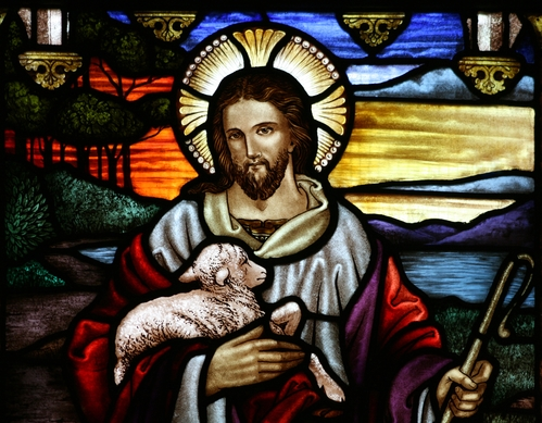 Stained glass image of Jesus holding a lamb