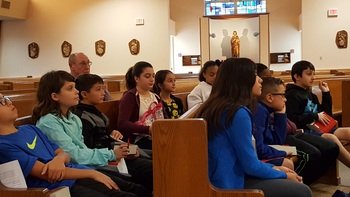 6th Grade Students Receive the Bible