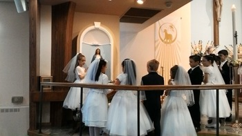 First Communion Students Crown the Blessed Virgin for Mother's Day