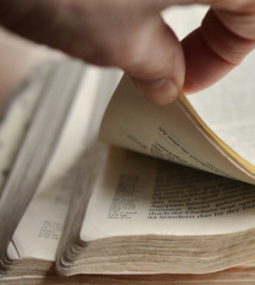 Picture of person opening Bible