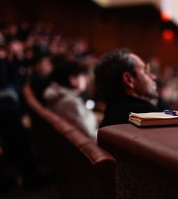 Picture of audience listening to speaker