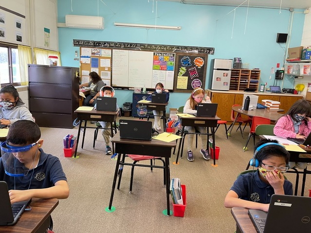 Students using Chromebooks purchased by Earthly Blessings.