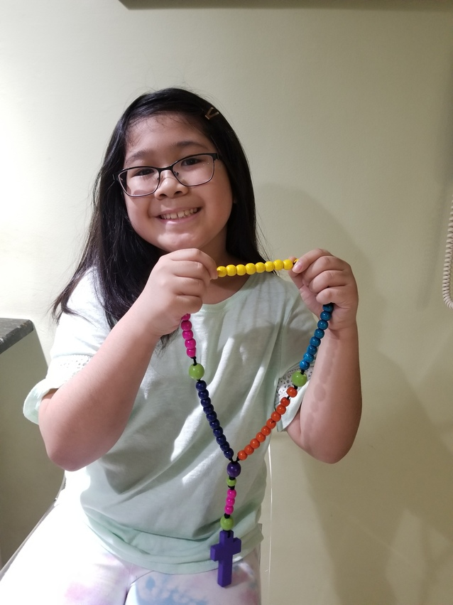 Religious Education student makes a Rosary.