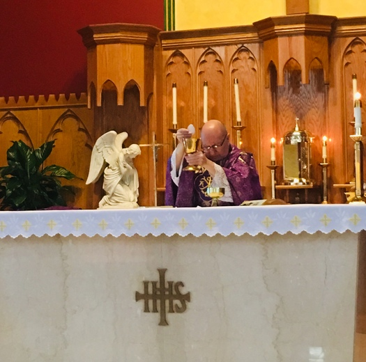 Father Anthony celebrating private mass