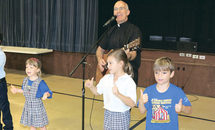 'Wednesday wake-ups' come courtesy of St. Angela's guitar-playing pastor