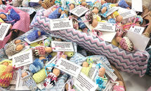 Unborn Baby models remind St. Elizabeth Ann Seton students of the preciousness of life