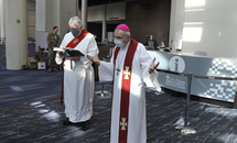 Archbishop Aymond blesses the medical facilities at the convention center