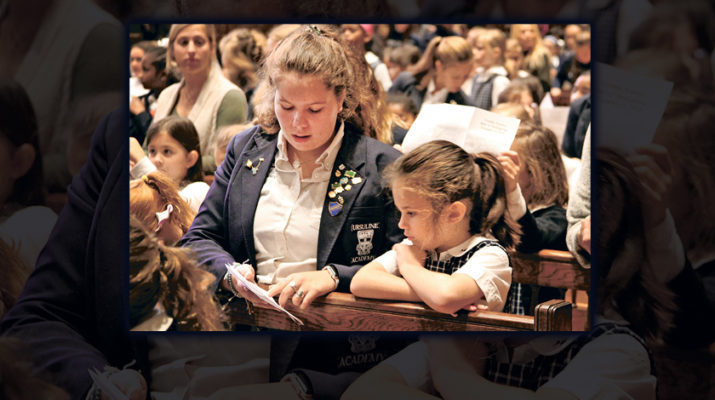 Mass buddies at Ursuline help younger students