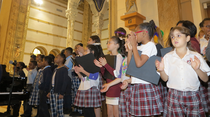 All together now! two elementary school CHoirs sing in unison