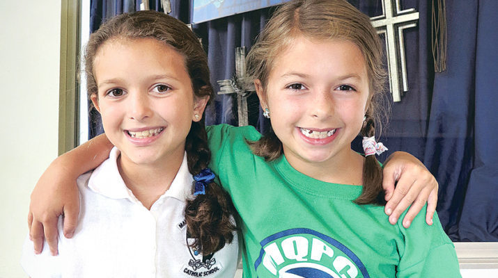 Mary Queen of Peace student-sisters make 'Hair Ties for Haiti'