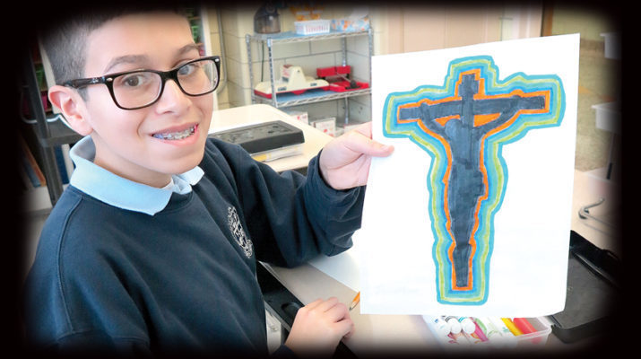Holy Rosary Elementary students embrace the cross, the crucifix in Lenten art classes