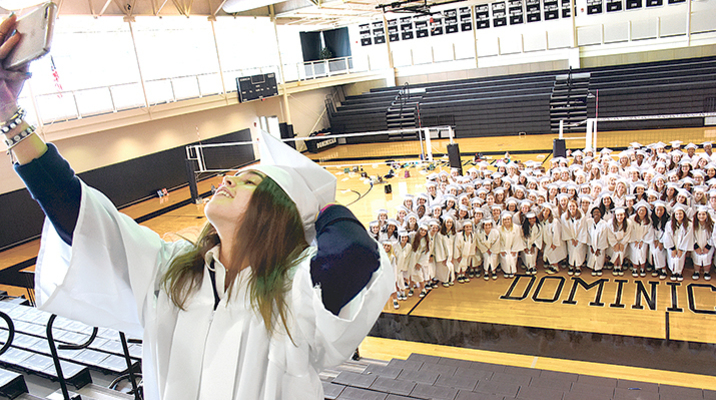 Dominican seniors celebrate caps and gowns with a group selfie