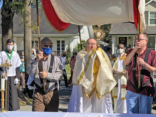 Eucharistic procession honors Christ the King