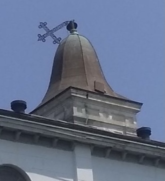 St. Augustine Church cross holds fast to its cupola