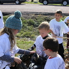 "Nativity Catholic School students ""rake in"" pledges to support their school"