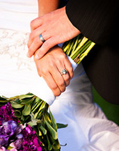 newlyweds clasping hands