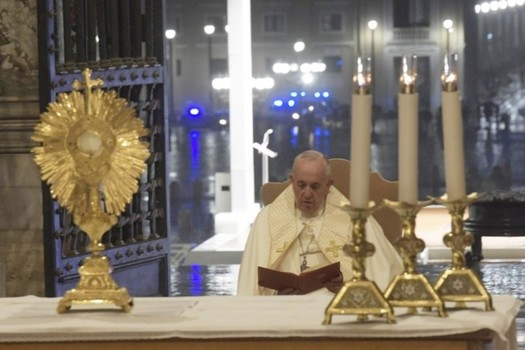 Pope Francis praying before the Blessed Sacrament