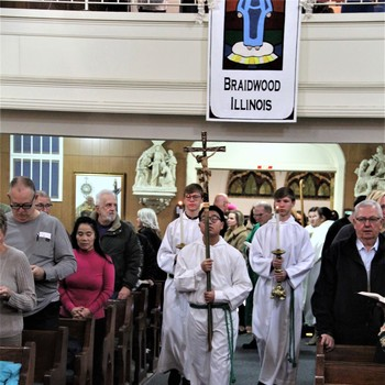 Why does Mass begin with a procession?