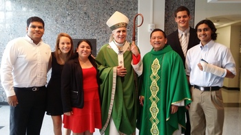 Cardinal DiNardo celebrates Mass with Fr. Joe Nguyen, CSSp.