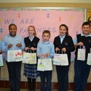 Students with holiday themed gift bags for cancer patients.
