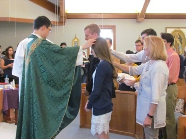 Fr. Daniel welcomes new members into the Church Easter 2019