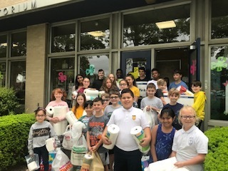 Holy family students contribute to our Parish pantry