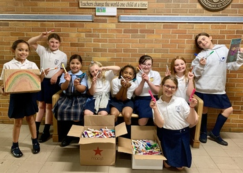 Holy Family School Girl Scouts help with Recycling Project!