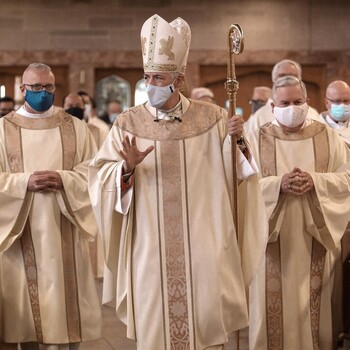 Oils used in Church rites blessed by bishop at annual Chrism Mass