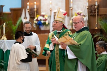 Priest welcomes role as 'father' to members of parish 'family'