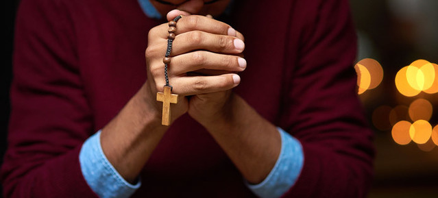 Person praying the rosary