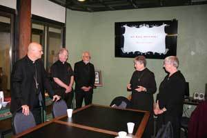(left to right) Bishop Edward Weisenburger, Msgr. Jeremiah McCarthy, Moderator of the Curia, and Bishop Emeritus Gerald Kicanas give their regards to Sister Joan and Sister Dawn at the Pastoral Center.
