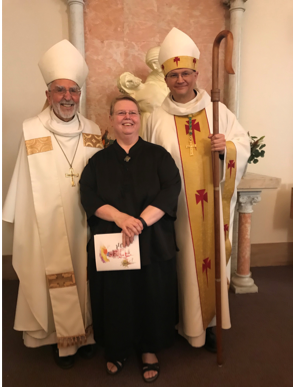 Sister Dawn Annette, OSB, Prioress General of the Congregation along with Bishop Emeritus Kicanas and Bishop Edward Weisenburger.