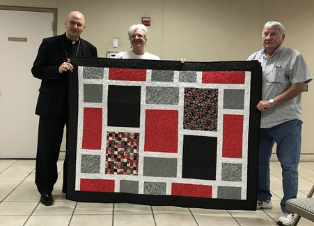 A quilting group at St. George's put together a beautiful quilt and presented it to me during my visit.